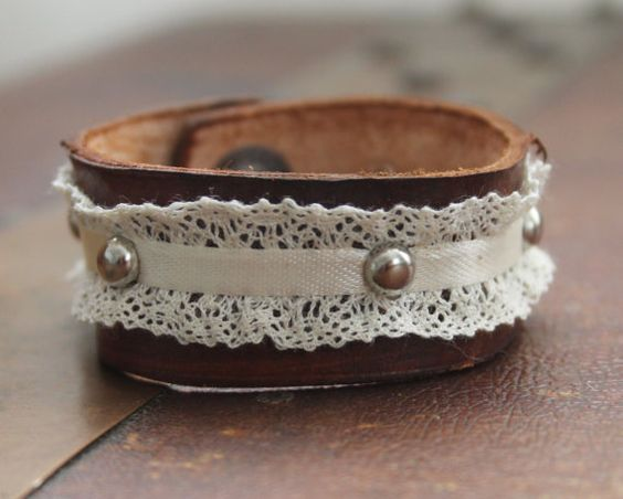 Custom leather cuff bracelet, made out of quality leather, lace, ribbon, and silver hardware. Over all length 7 1/2. Snaps at 7
