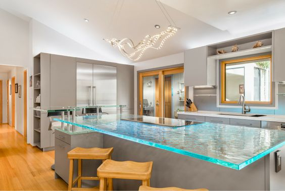 Cast glass countertops with LED lighting can make a dramatic impact in a contemporary home. Click through to learn more.