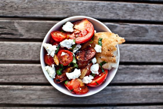 chorizo and tomato salad. photo via greedy gourmand.
