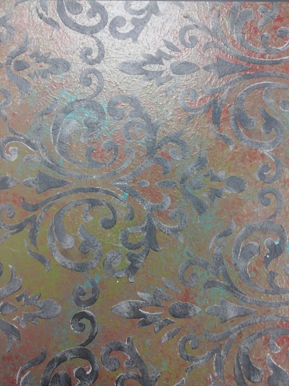 I used 4 Annie Sloan Chalk Paint(R) colors mixed with Artisan Enhancements Scumble to create the blended finish under the stencil.  The stencil is an Artisan Enhancements new stencil called Ventian Damask