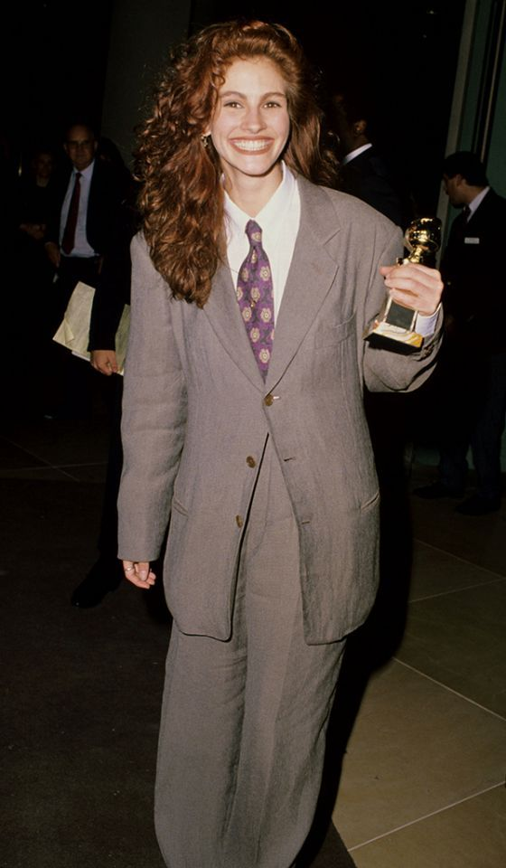 The Golden Globes (1990) Roberts took home her first Golden Globe for her supporting role in 'Steel Magnolias' on Jan 20, 1990. She showed of her self-described 'whimsical sense of style' by arriving in an oversized Giorgio Armani men's suit. (photo: Steve Granitz, WireImage):