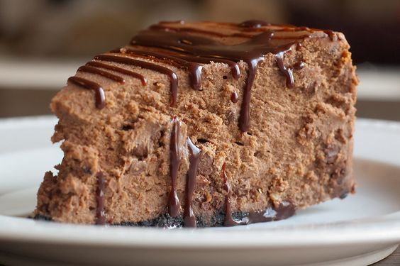 Triple Chocolate Cheesecake with Chocolate Kahlua Sauce (I made it today and it was decadent! A keeper-recipe! I mixed the sauce just from chocolate sauce and Kahlua......Enjoying one sliver right now - yum!)