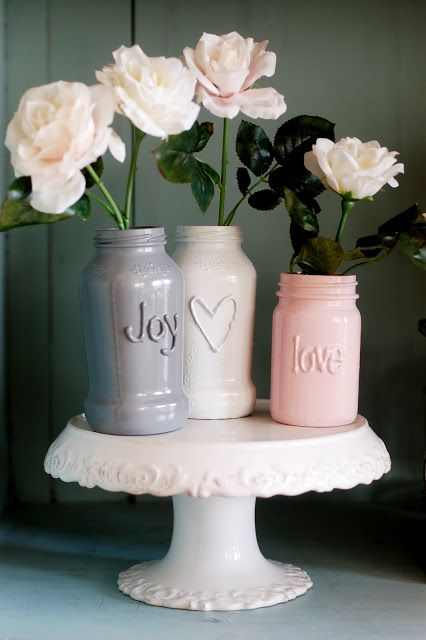 Take your hot glue gun, eyeball your letters and allow time to dry.  Remove all little glue strings from the jar or else they will show up in your finished product. First add a primer to your jar and then paint it the color of your choice.