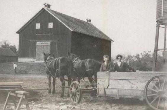 Jerome Hill and an unidentified woman in farm wagon with present farm site in background, North Oaks, Minnesota, 1911 #jjhill #northoaks #farm #minnesota