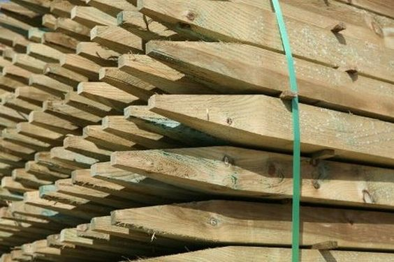 Using nanotechnology to prevent chemical leaching of treated wood