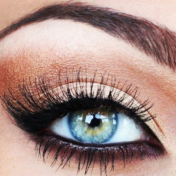 Copper & black eye makeup...blue eyes pop.