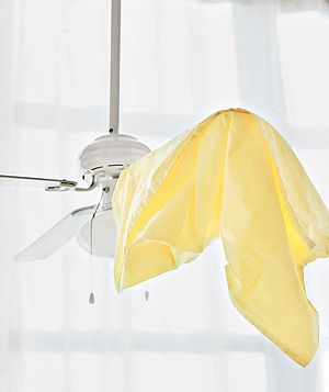 Clean your fan using a pillowcase eliminates dust in your face.