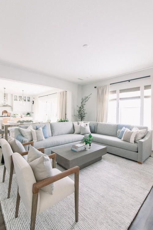 Light Gray Fabric Sectional Wood And Cream Sitting Chairs Neutral Area Rug Concrete Coffee Table Window In 2020 Living Room Grey Home Living Room Livingroom Layout