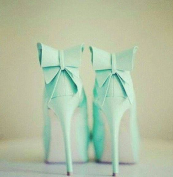 Mint green heels with a bow on top I'd probably fall on my butt but they're cute
