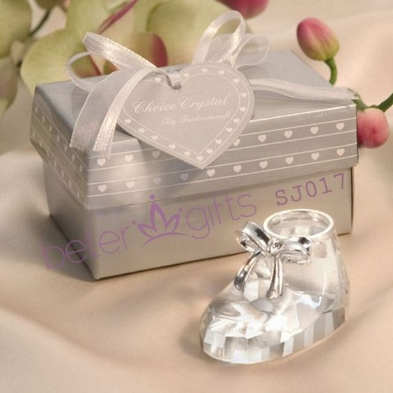 """Choice Crystal Baby Shoe Celebrate your brand new baby with these crystal baby shoes from the """"Choice Crystal Collection""""! Your guests will find these baby shoes simply adorable with their intricate details. An excellent addition to any baby showers you may be planning!Features and Facts:Shoe Size: 2"""" x 1.125"""";Box Size: 3.25"""" x 2.25"""";Each crystal favor comes in the shape of a baby shoe accented with a silver metal bow;Packaged in a satin-lined signature """"Choice Crystal"""""""