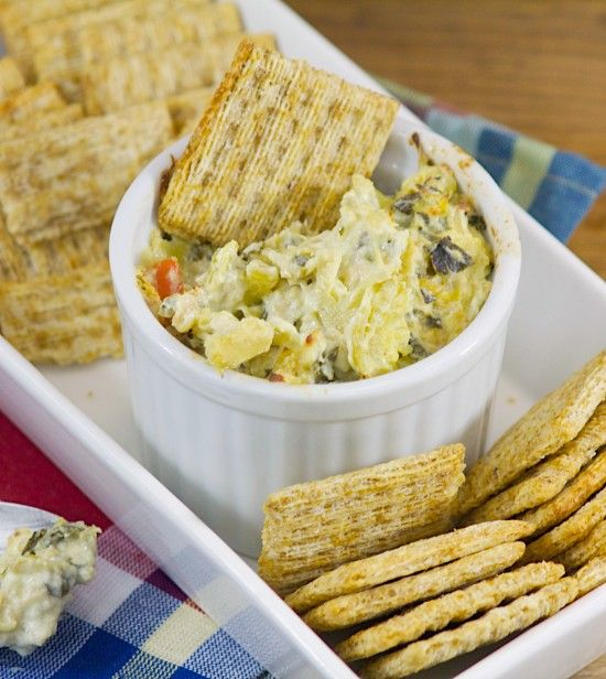 Baked Spinach Artichoke Dip that will please your game-day crowd. Using fresh spinach and two cheeses, this is one awesome dip. www.lorisculinarycreations.com