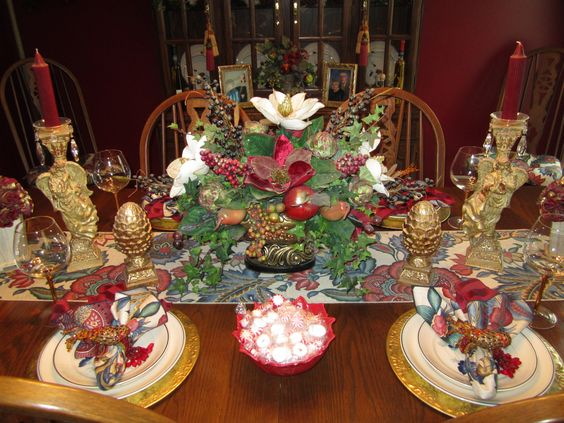 my dining room table..I made the flower arrangement in an old antique pot/urn I found in my grandmother's attic after she died