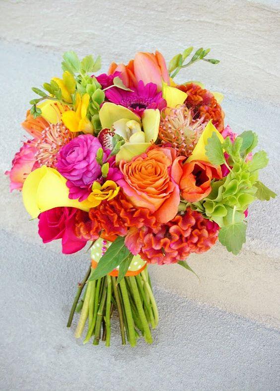 bright! Roses, ranunculus, tulips, bells, protea, orchids, mini callas, coxscomb... love! #wedding #bouquet