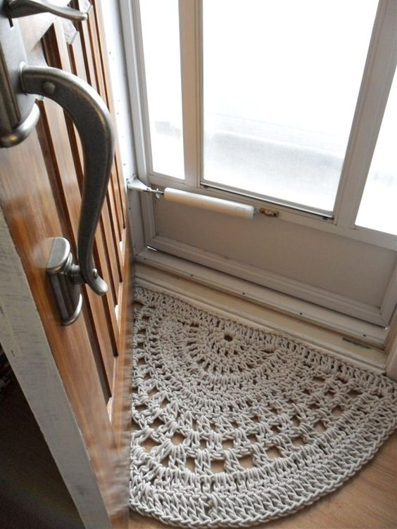 Crochet door mat...make with plastic bags? Inspiration only--what about one for outside? What a great way to do one that is waterproof!: