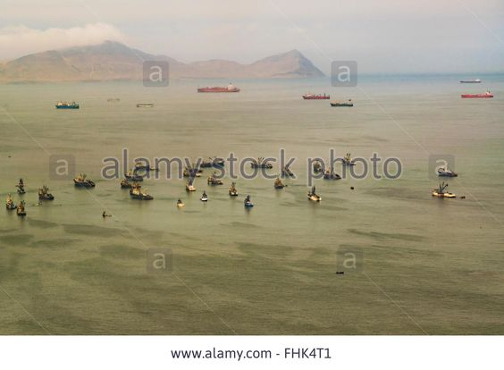 Download this stock image: Aerial view shot from window plane of a group of commercial ships in the waters of the pacific ocean near the coast of Lima in P - FHK4T1 from Alamy's library of millions of high resolution stock photos, illustrations and vectors.