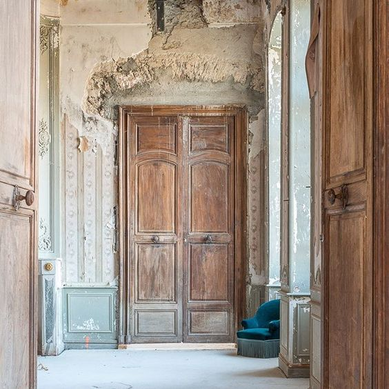 Old world doors and magnificent stripped wallpaper and decaying walls within Chateau de Gudanes. Weathered Walls & Déshabillé Lovely. #French #chateau #doors #paneled #walls #distress #weathered #oldworld #wallpaper