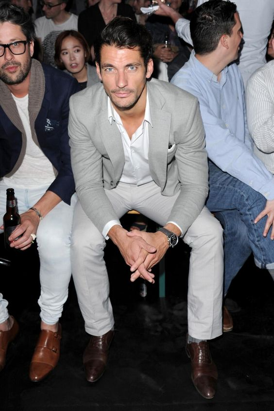 David Gandy and Larry King, front row at the Superdry S/S '15 event pre- London Collections: Men June, 2015.  David is wearing a Lawson Walker blazer, Club Monaco trousers, and Cutler and Gross sunglasses. June 14, 2014.