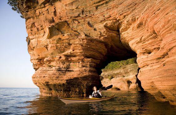 Woman Sea Kayaking in Apostle Islands - Joe Michl/Getty Images
