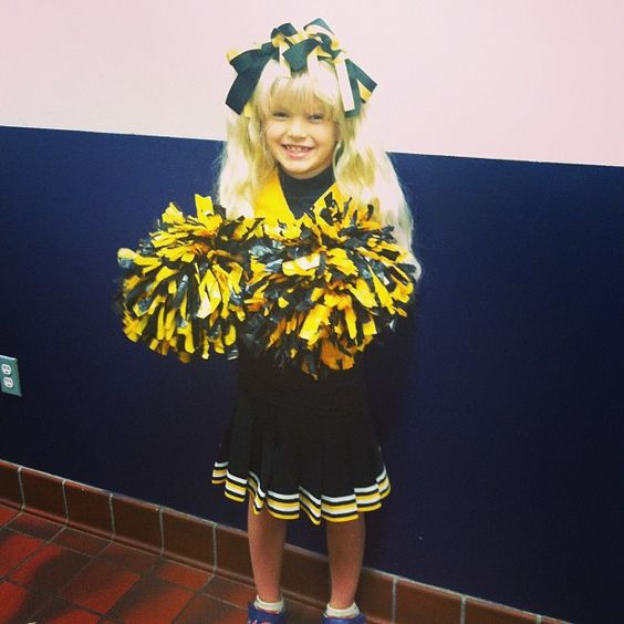 Wearing Aunties old cheering uniform.