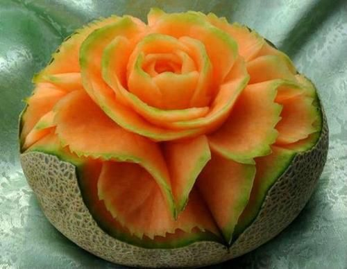 Cantaloupe flowers.. This is creative.. I'm gonna do this sometime!!
