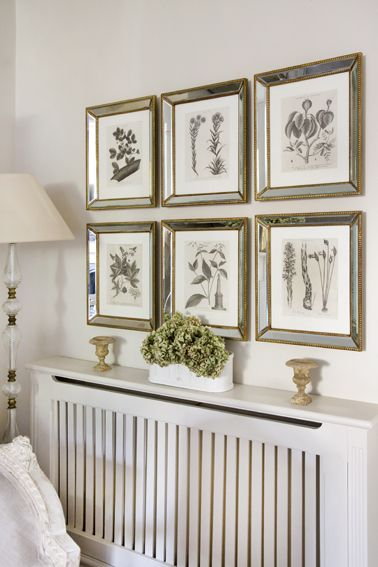 botanical prints over a covered radiator