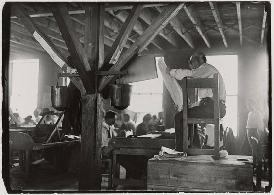 """""""A 'reader' in a cigar factory""""  By Lewis Hine, unknown location, 1909  Spanish speaking cigar makers in Florida and eastern European cigar makers in New York City sometimes pooled their wages to hire another worker to read newspapers or political tracts aloud while they worked. While this tradition was unique to cigar-making, workers in other trades also found ways to make the time pass more quickly by singing, playing practical jokes, and talking."""