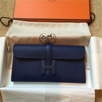Herms Jige Blue Clutch. Get the trendiest Clutch of the season! The Herms Jige Blue Clutch is a top 10 member favorite on Tradesy. Save on yours before they are sold out!