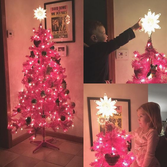 We got a pink tree!! . Merry December 2nd.  Even sick the girl couldn't resist decorating.
