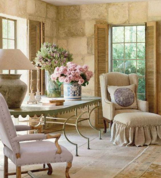 French farmhouse living room with antiques, limestone, and shutters on Hello Lovely Studio #PamelaPierce #FrenchCountry #ChateauDomingue