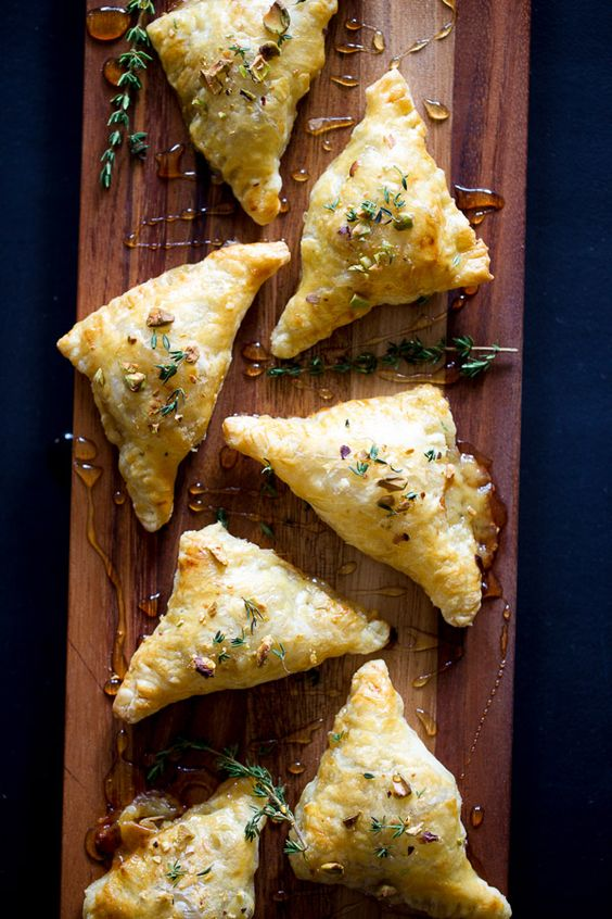 Pear and proscuitto triangles with triple creme brie