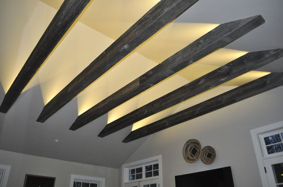 Beams Are Wrapped In Old Barn Siding That Give Them A Rustic Look Recessed L
