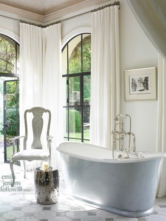 love the arched steel doors & windows in this bathroom