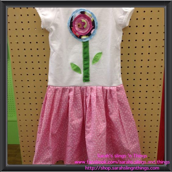 T-shirt dress with hand stitched flower (raw edges for fraying and it's worn) and pink pleated ruffle skirt