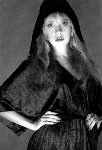 "Stevie~ ""Her black robe trailing...sister of the moon. She was dark as the tower of herself~and she called to me. And the black widow spider makes~more sound than than she.... From Sisters of The Moon..."