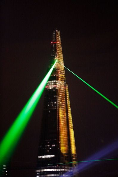 LONDON, ENGLAND - JULY 05: Laser lights shine from The Shard over Tower Bridge on July 5, 2012 in London, England. (Photo by Matthew Lloyd/Getty Images)