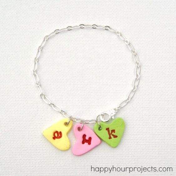 Conversation Heart Charm Bracelet made with polymer clay http://happyhourprojects.com/2013/01/conversation-heart-charm-bracelet.html