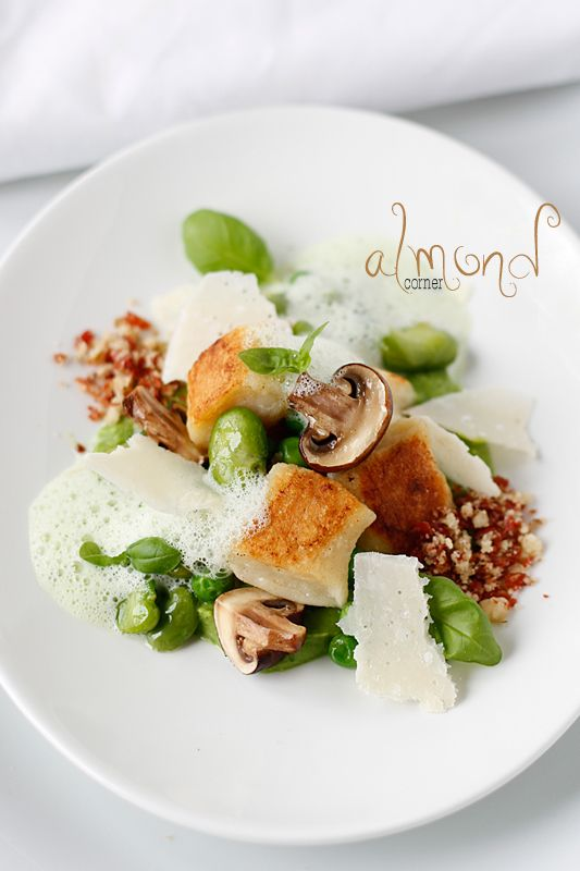 Sheep's milk cheese gnocchi on basil scented pea puree, parma ham-walnut crumble, parsley foam and fava bean ragout