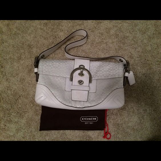 Coach Shoulder Purse Color: White. Two slip pockets and one zipper pocket inside. Shows signs of normal usage (back bottom corner has some light markings, I'm sure can be cleaned). Comes with dust bag. Coach Bags