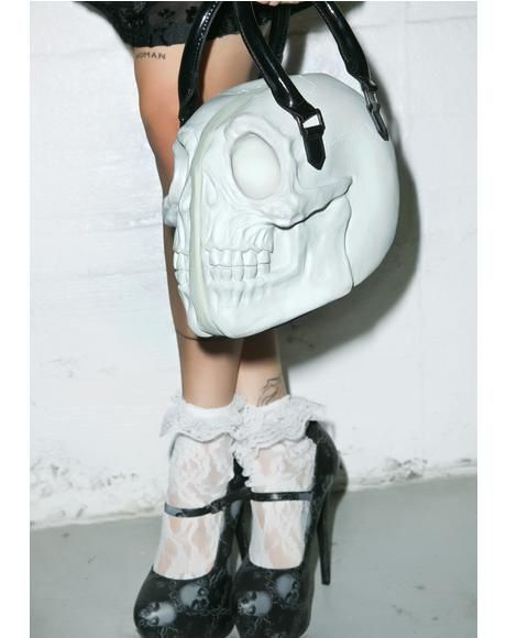 Creep it up with our skull handbag. Available in pink as well!