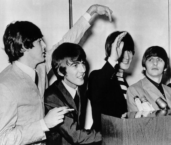 A press conference for the Beatles at the Hilton Hotel, in San Francisco, on August 19, 1964, brightened when they were asked which of the foursome was married. John Lennon second from right, owned up and was pointed out by Paul McCartney, left. Second from left is George Harrison, and at right, is Ringo Starr. Their Cow Palace appearance had been sold out for months. (Photo by AP Photo)