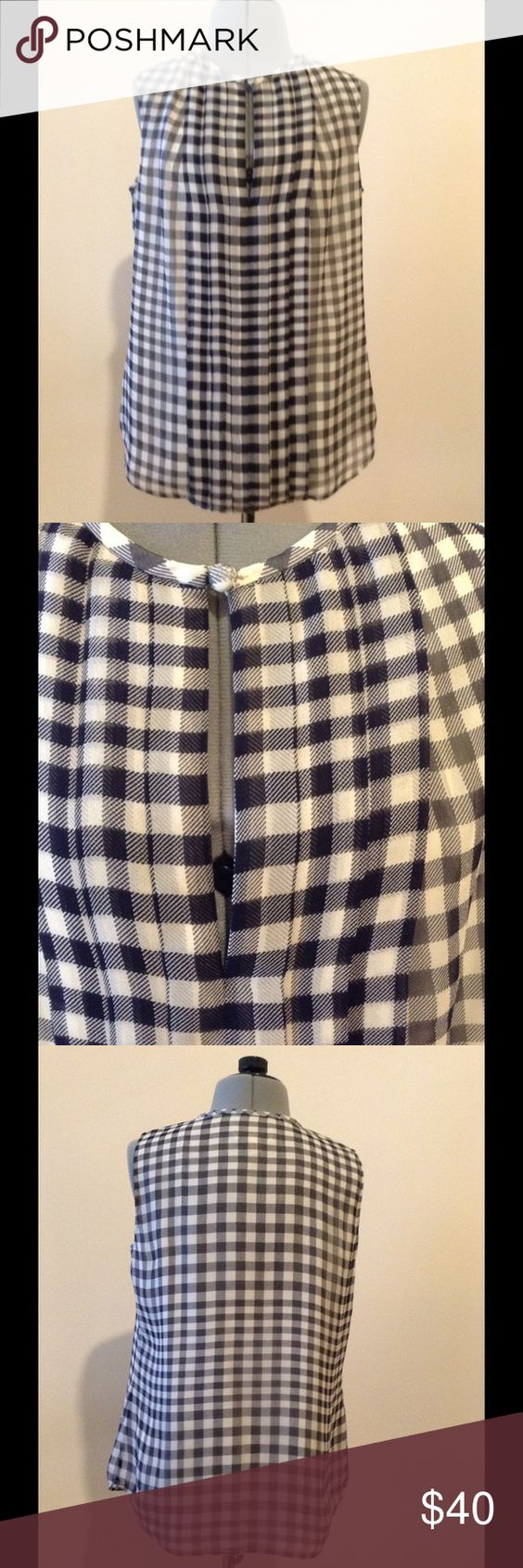 "J Crew silk keyhole plaid blouse This silk blouse is so versatile, you will find yourself grabbing for it all the time! Measurements: ( laying flat) shoulder to shoulder: 12.25"", bust: 16.50"", waist: 17"", hip: 18"", length: 23.15"". Size 00. She'll: 100% silk, lining: 100% polyester. J. Crew Tops Blouses"