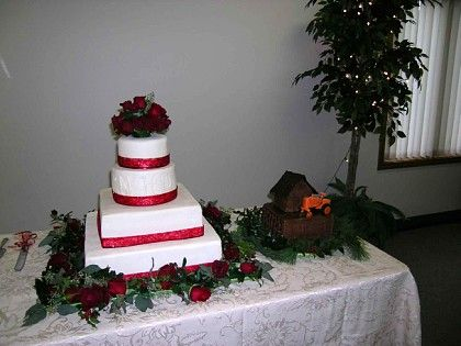 Wedding with groom's AC tractor cake
