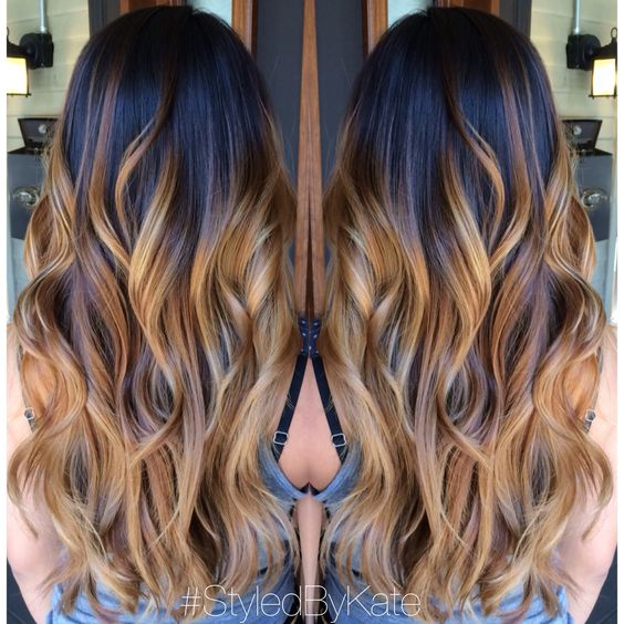 Blonde and caramel Balayage/Ombre over natural brunette hair. Loose curls and long layers