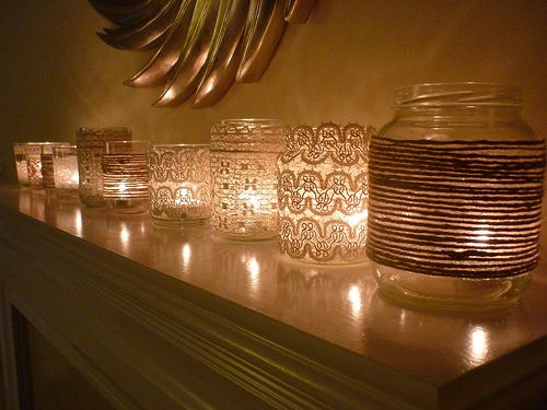 Vintage lace covering jars and vases and then adding tea lights. I am loving the light these give off.