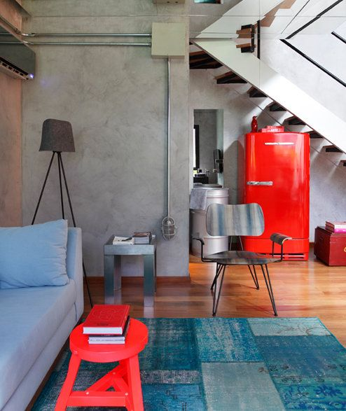 Using the basement concrete walls to inspire a cool industrial design. Love the color and mirrored ceilings!