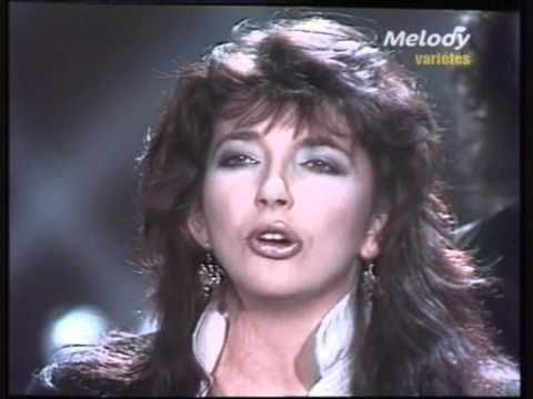 kate bush   running up that hill  she's either really feeling this song or stoned out of her mind lol