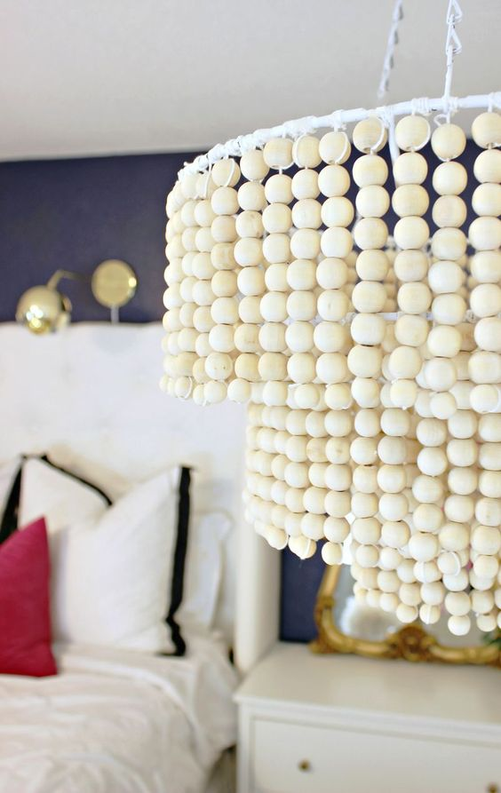 Love this DIY Wood Bead Chandelier - Click for tutorial: