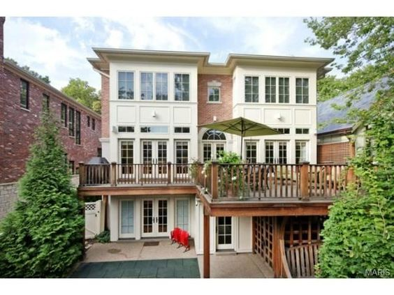 French doors open to a large outdoor deck and space  | Clayton MO