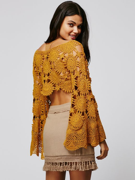 Sunchaser Crochet Top | Inspired by decades past this wide knit crochet top is in a cropped silhouette with vintage-inspired long sleeves and dramatic wide cuffs. Scalloped uneven trim.