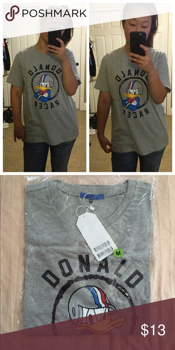 "Donald Duck Graphic Tee Company: UNKNOWN Size: MEDIUM MADE IN KOREA Fabric:  -- Front Length: "" Chest: "" Waist: "" -- NEVER WORN -- #donaldduck #graphictees #backtoschool #casual #grey #tops #tshirts #cute Tops Tees - Short Sleeve"